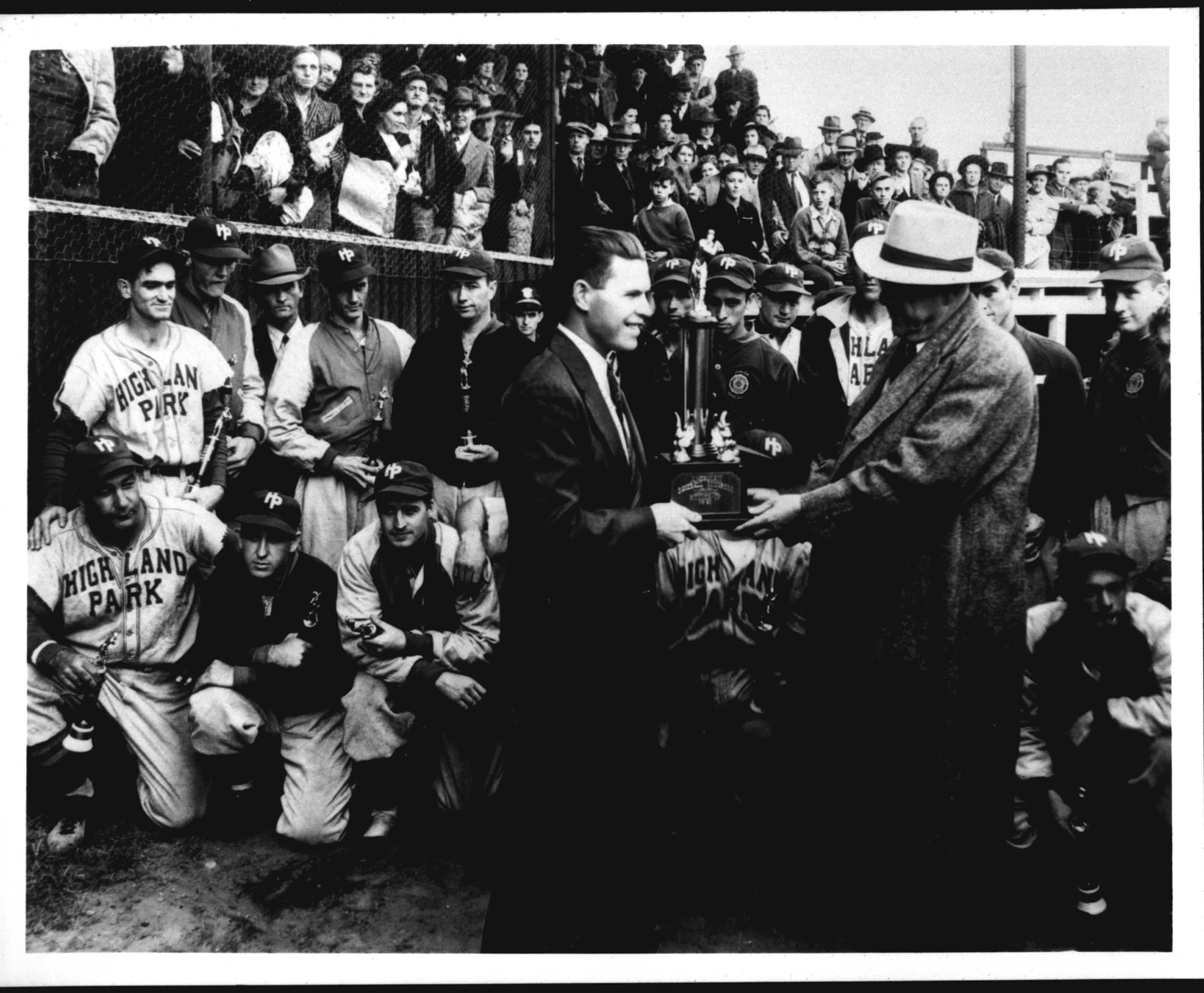 Luther Brackett began working at the Highland Mill Park #3 in 1934. He started as a trainee, but eventually became the General Manager of the mill until it closed in 1969. Brackett accepted, on behalf of the Highland Park baseball team, a trophy for placing second in the 1941 National Amateur World Series in Battle Creek, Michigan.