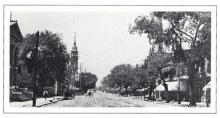 1903 view of North Tryon Street. New Carnegie Library at extreme left.