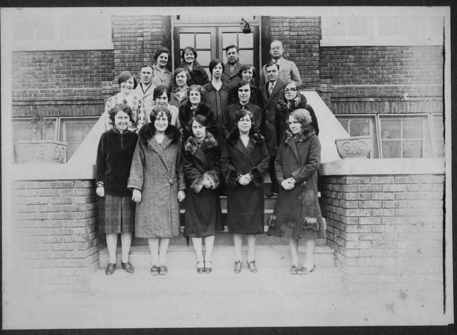 The teachers at Tech High stand in front of the school for this 1926 photograph. First Row: Mabel Underwood, Mary Sossoman, Lottie Ona Barkley, Aubin Wert, Thelma Ashworth. Second Row: Helen McManus, Carolyn May, Ruth Brawley, Ruth Kohn, Helen Dodds. Third Row: O.P. Littell, Nattye McNinch, Lula Faye Clegg, Daphne Ransom, S. L. Gunderson. Fourth Row: Stella Kittles, Maie Myers, N.F. Collage and Forest T. Selby.