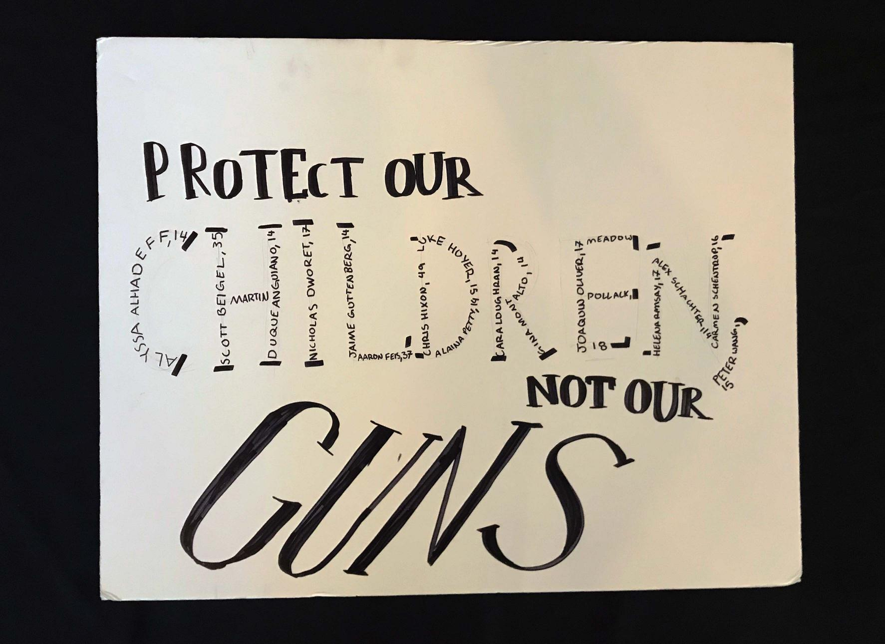 "Charlotte March for Our Lives, 2018. Sign reads: ""Protect our children, not our guns."""