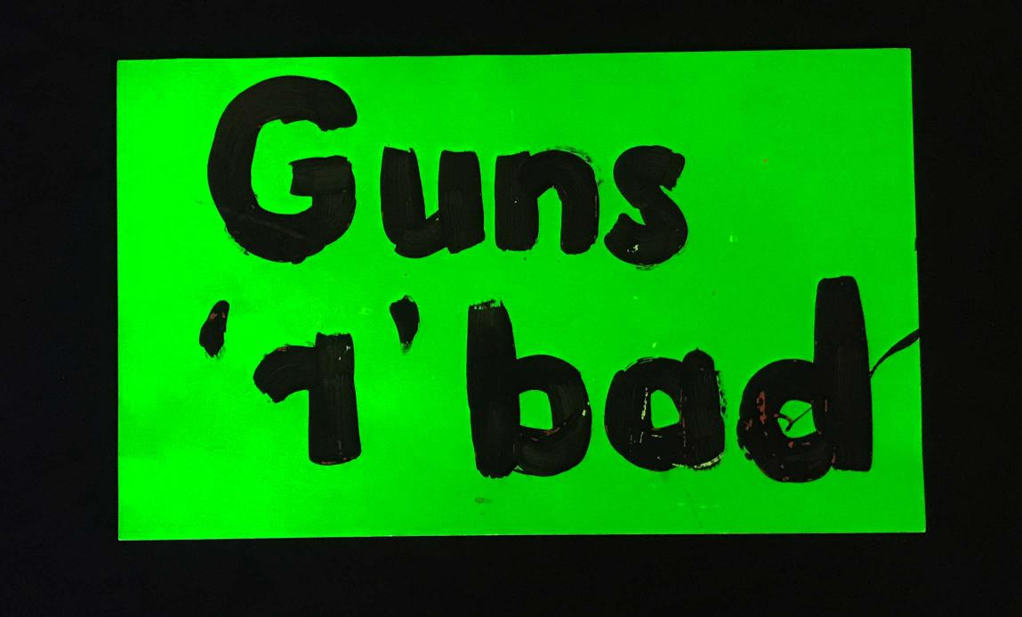"Charlotte March for Our Lives, 2018. Sign reads: ""Guns r bad"""