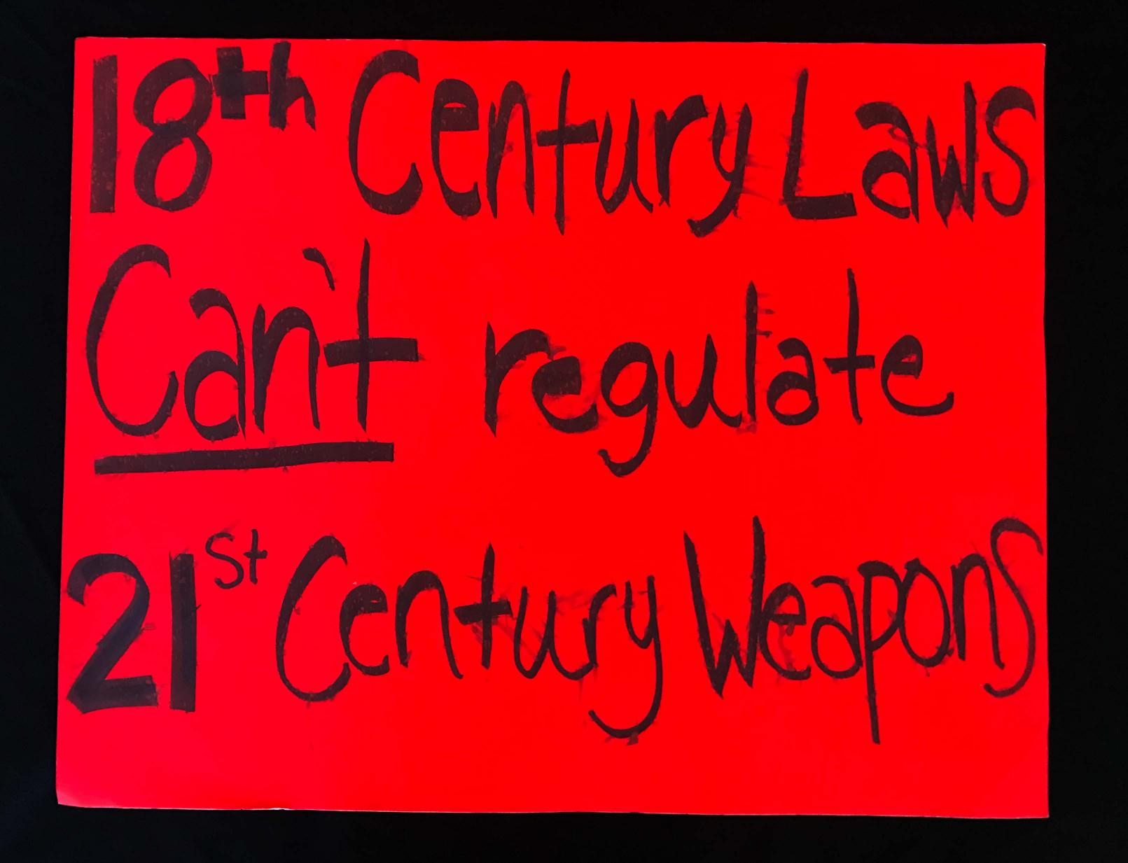 "Charlotte March for Our Lives, 2018. Sign reads: ""18th-century laws can't regulate 21st-century weapons."""