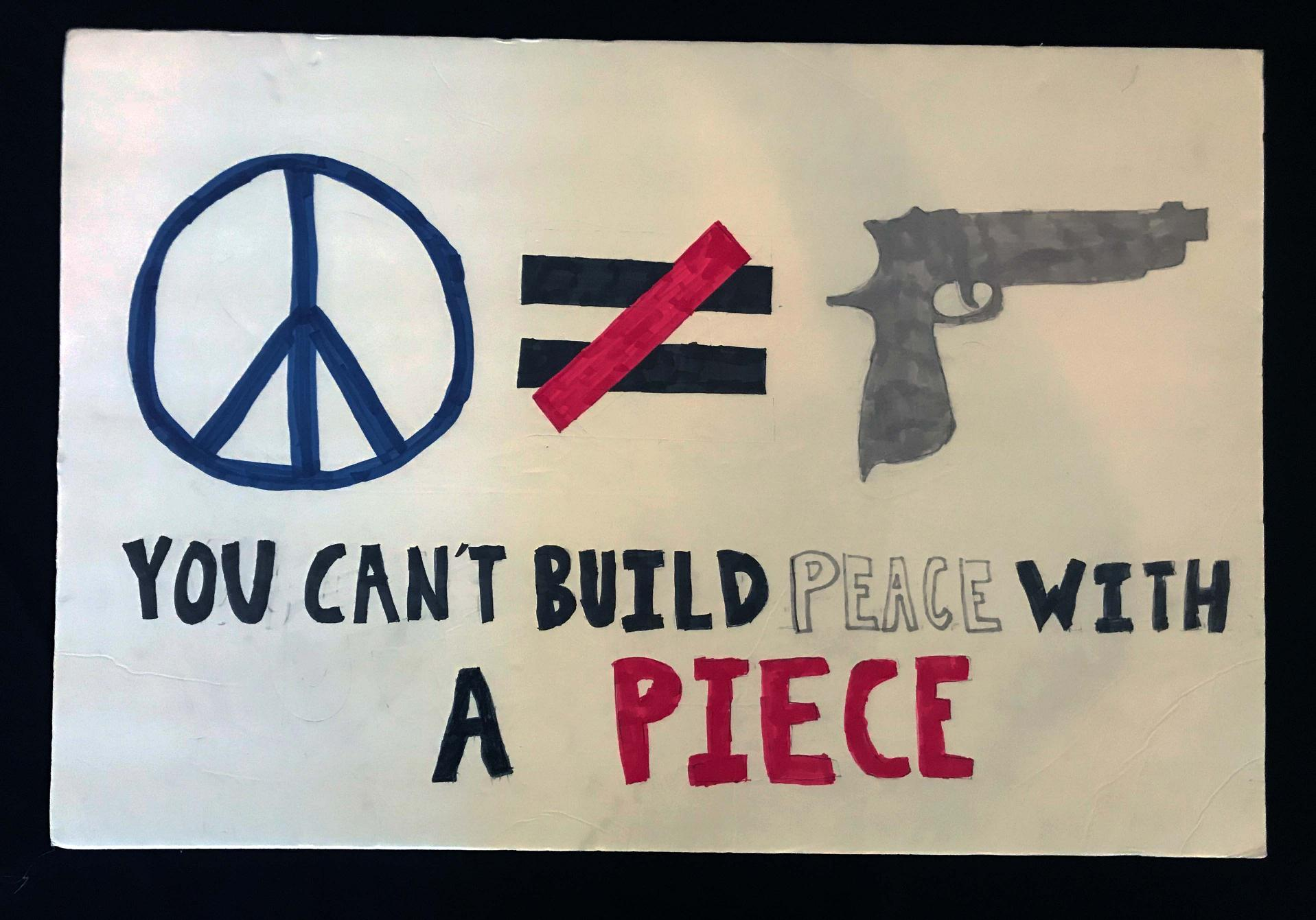 "Charlotte March for Our Lives, 2018. Sign reads: ""You can't build peace with a piece."""