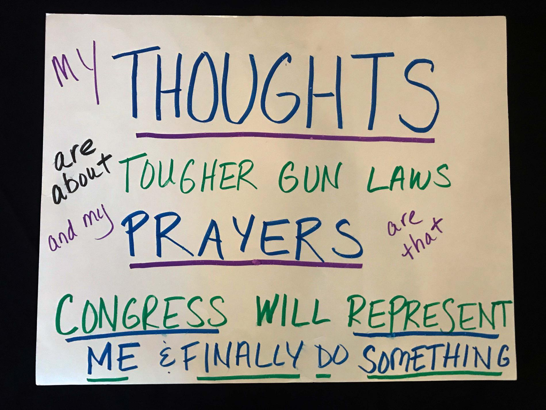 "Charlotte March for Our Lives, 2018. Sign reads: ""My thoughts are about tougher gun laws, and my prayers are that Congress will represent me and finally do something."""
