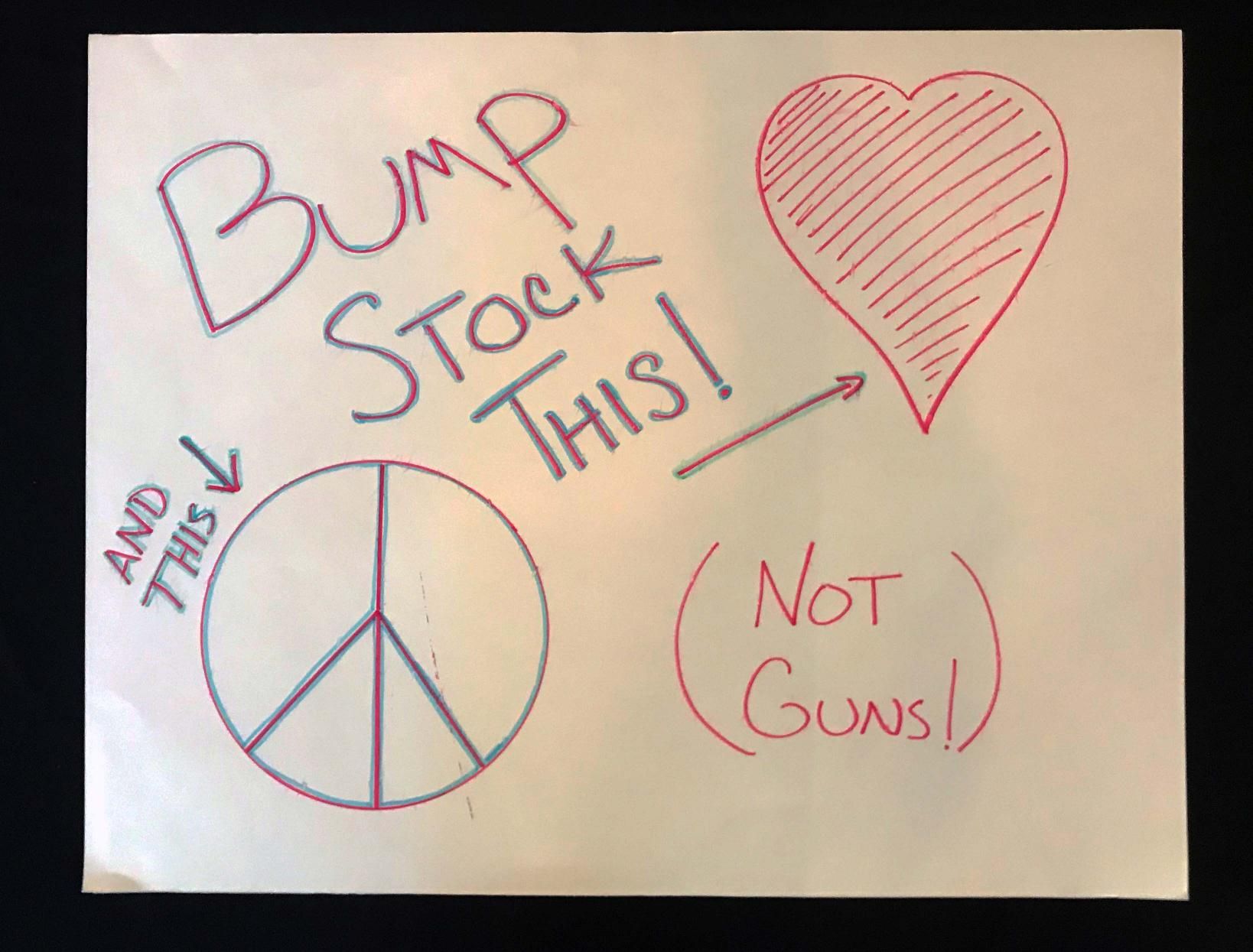 "Charlotte March for Our Lives, 2018. Sign reads: ""Bump stock this [peace sign] and this [heart]! Not guns!"""
