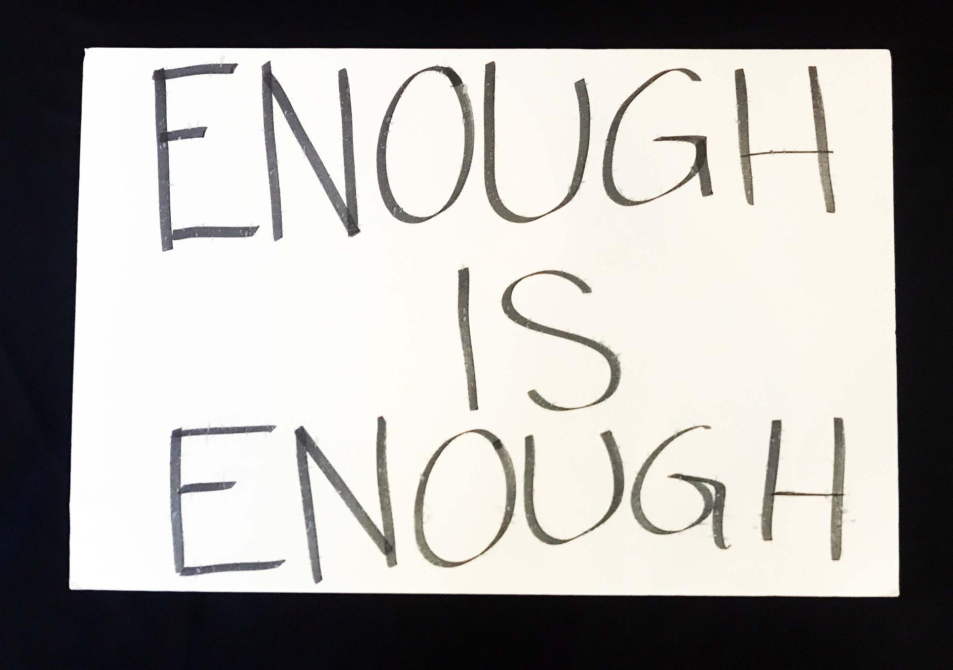 "Charlotte March for Our Lives, 2018. Sign reads: ""Enough is Enough."""